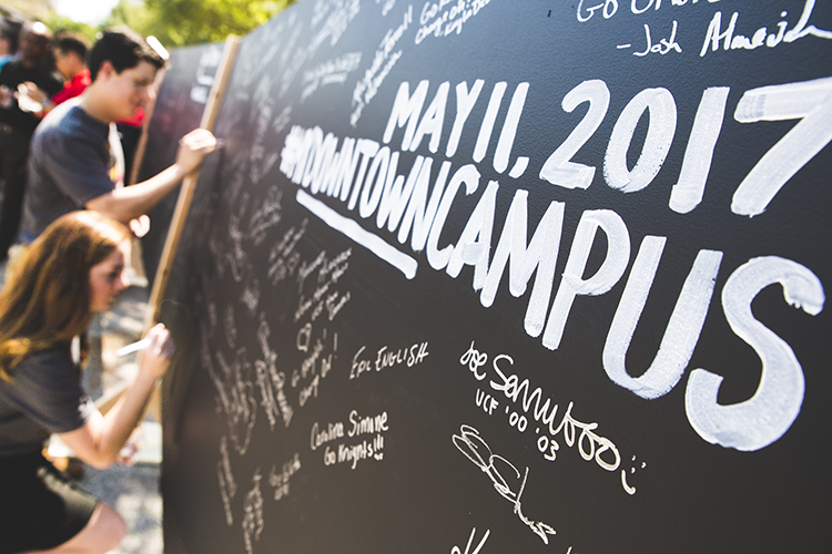 Students Signing Wall